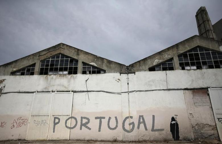 Graffiti depicting the angel of death, with the word ''Portugal'', is seen at a closed factory in Lisbon August 5, 2013. REUTERS/Rafael Marchante