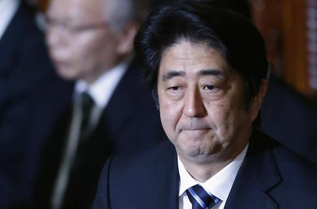 Japan's Prime Minister Shinzo Abe attends at the plenary session of the Lower House of the parliament as it rejects a no-confidence resolution against the Cabinet, in Tokyo December 6, 2013 file photo. REUTERS/Yuya Shino
