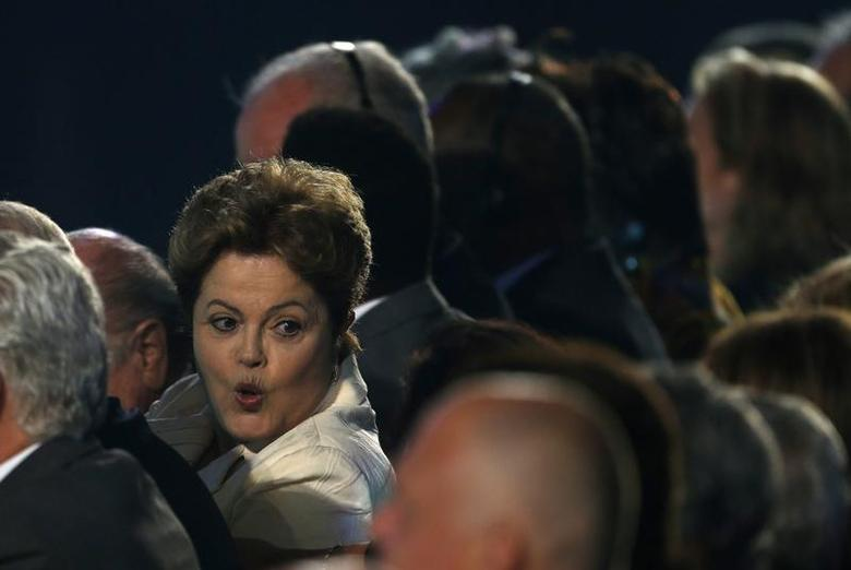 Brazil's President Dilma Rousseff attends the draw for the 2014 World Cup at the Costa do Sauipe resort in Sao Joao da Mata, Bahia state, December 6, 2013. REUTERS/Paulo Whitaker