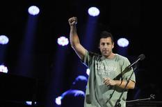 "Adam Sandler performs during the ""12-12-12"" benefit concert for victims of Superstorm Sandy at Madison Square Garden in New York December 12, 2012. REUTERS/Lucas Jackson"