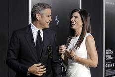 "Actors George Clooney and Sandra Bullock arrive for the film premiere of ""Gravity"" in New York October 1, 2013. REUTERS/Andrew Kelly"