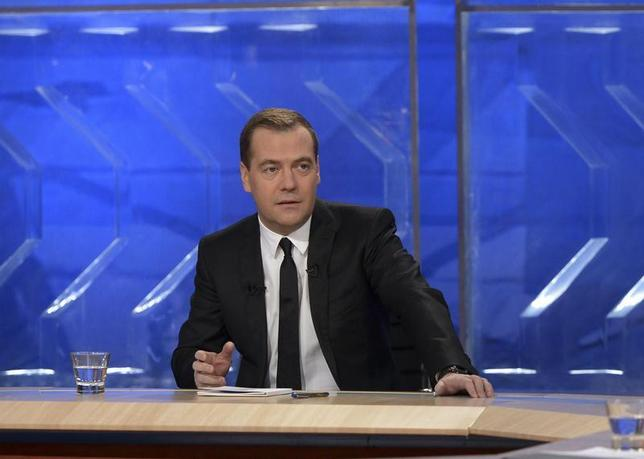Russian Prime Minister Dmitry Medvedev gives an interview to federal TV channels at the Ostankino TV Center in Moscow December 6, 2013. REUTERS/Alexander Astafyev/RIA Novosti/Pool