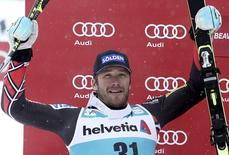 Bode Miller of the U.S. celebrates his second place finish in the men's World Cup Giant Slalom ski race in Beaver Creek, Colorado December 8, 2013. REUTERS/Mark Leffingwell