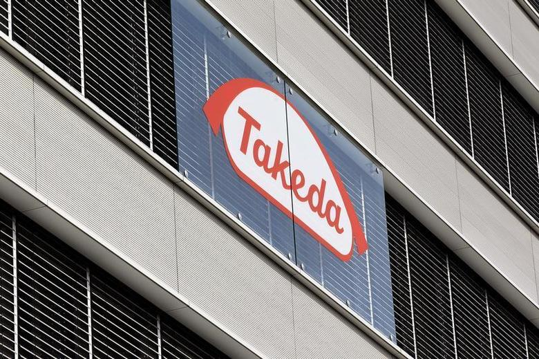 The logo of Japanese Takeda Pharmaceutical Co is seen at an office building in Glattbrugg near Zurich March 7, 2012. REUTERS/Arnd Wiegmann