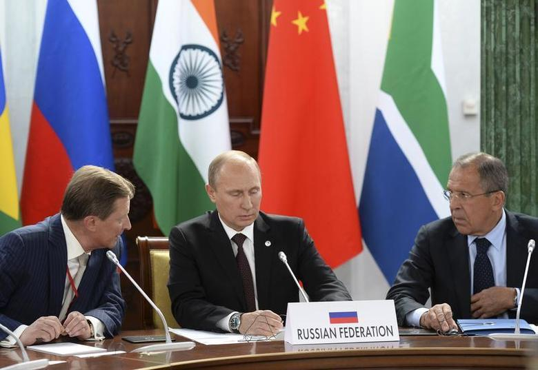 Russia's President Vladimir Putin (C), Foreign Minister Sergei Lavrov (R) and Chief of Staff of the Presidential Administration Sergei Ivanov attend a BRICS leaders' meeting at the G20 Summit in Strelna near St. Petersburg, September 5, 2013. REUTERS/Alexander Vilf