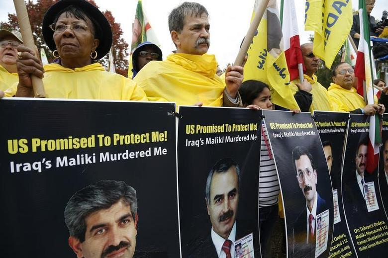 Supporters of Iranian opposition group Mujahadin-e-Khalq (MEK) rally against Iraq's Prime Minister Nuri al-Maliki hours before he is scheduled to meet with U.S. President Barack Obama, outside the White House in Washington, November 1, 2013. REUTERS/Jonathan Ernst