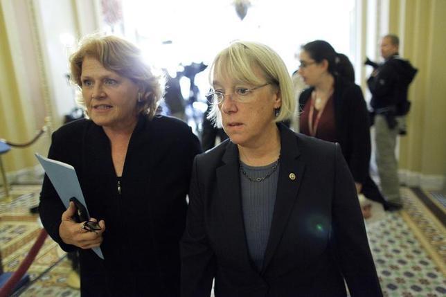 U.S. Senator Patty Murray (D-WA) (C) walks to a Senate Democratic caucus luncheon at the U.S. Capitol in Washington, October 15, 2013. REUTERS/Jonathan Ernst