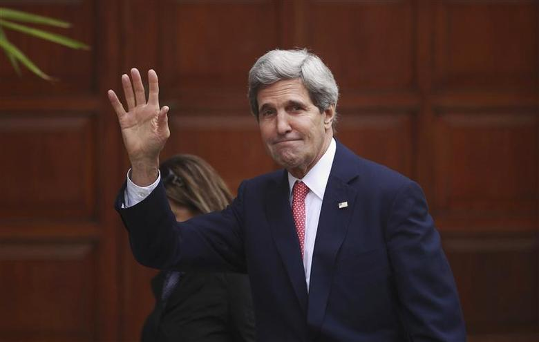 U.S. Secretary of State John Kerry waves upon arrival for a meeting with Palestinian President Mahmoud Abbas in the West Bank city of Ramallah December 5, 2013. REUTERS/Mohamad Torokman