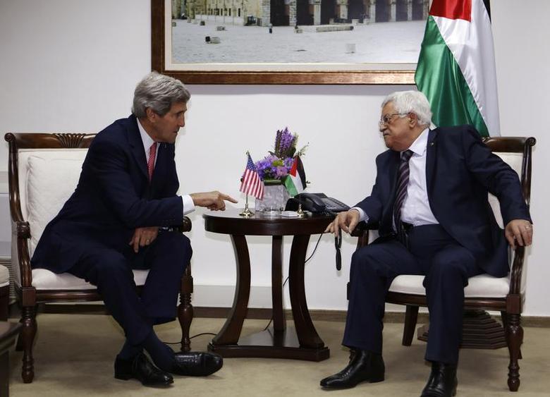 U.S. Secretary of State John Kerry (L) meets Palestinian President Mahmoud Abbas in the West Bank city of Ramallah December 5, 2013. REUTERS/Mohamad Torokman