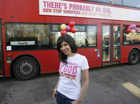 Atheist Bus Campaign creator Ariane Sherine poses for photographers in front of a bus bearing an atheist advertisement, at the launch of the campaign, in London January 6, 2009. REUTERS/Andrew Winning/Files