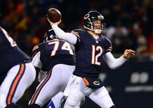 Dec 9, 2013; Chicago, IL, USA; Chicago Bears quarterback Josh McCown (12) throws a pass during the third quarter against the Dallas Cowboys at Soldier Field. Mandatory Credit: Andrew Weber-USA TODAY Sports - RTX16BRB