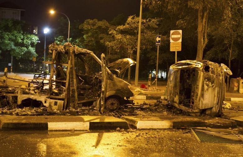 The burnt shells of vehicles are pictured along Race Course Road following a riot near Singapore's Little India district December 9, 2013. REUTERS/Stringer