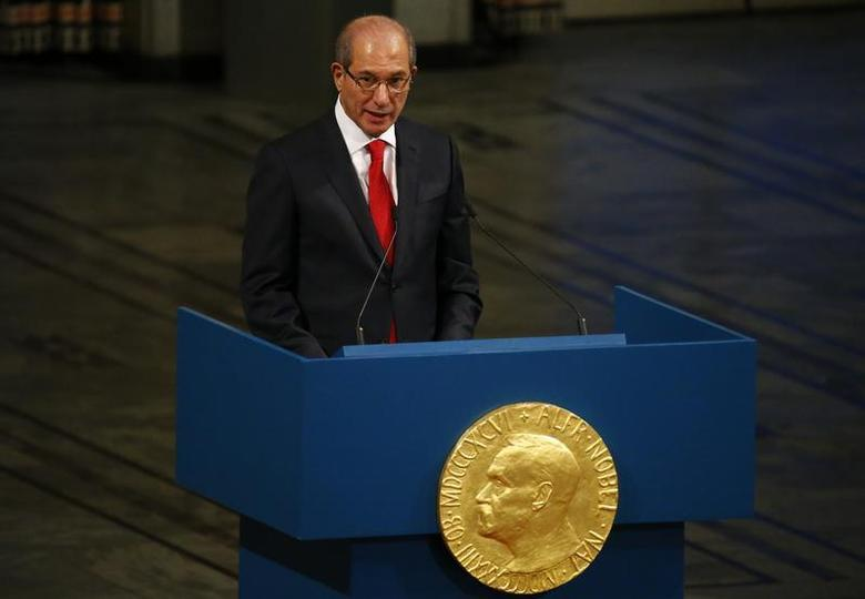 Ahmet Uzumcu, director general of the Organisation for the Prohibition of Chemical Weapons (OPCW) delivers a speech during the Nobel Peace Prize awards ceremony at the City Hall in Oslo December 10, 2013. REUTERS/Tobias Schwarz