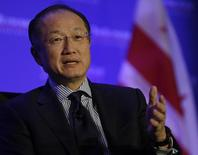 World Bank President Dr. Jim Yong Kim is interviewed by the President of the Economic Club of Washington David Rubenstein (not pictured) during a morning breakfast session in Washington December 10, 2013. REUTERS/Gary Cameron