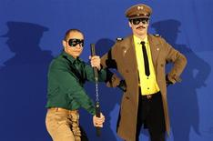 "Portuguese actor Goncalo Waddington (R), dressed as ""Capitao Falcao"" (Captain Falcon), and actor David Chan, dressed as Partridge Kid, pose for photos during the filming of ""Capitao Falcao"" in Lisbon December 3, 2013. REUTERS/Hugo Correia"
