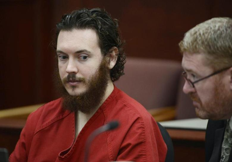 James Holmes and his defense attorney Daniel King (R) sit in court for an advisement hearing at the Arapahoe County Justice Center in Centennial, Colorado June 4, 2013. REUTERS/Andy Cross/Pool
