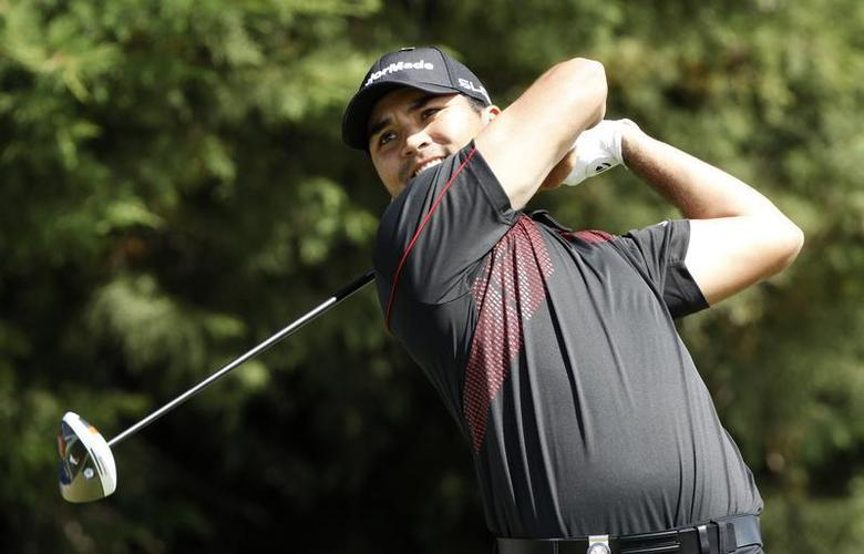 Australia's Jason Day plays a tee shot during the final round of the World Cup of Golf at The Royal Melbourne Golf Club in Melbourne November 24, 2013. REUTERS/Brandon Malone