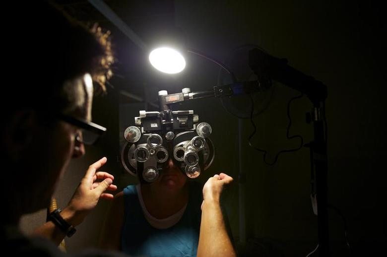 A patient has an eye exam at the Remote Area Medical (RAM) clinic in Wise, Virginia July 20, 2012. REUTERS/Mark Makela