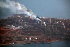 Smoke billows from chimneys at the Rio Tinto alumina refinery in Gove, also known as Nhulunbuy, located 650 kilometers (404 miles) east of Darwin in Australia's Northern Territory July 16, 2013. REUTERS/David Gray
