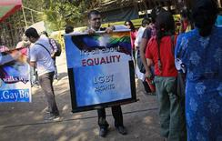 A gay rights activist folds a banner at a protest organised against the Supreme Court's order on gay sex in Mumbai December 11, 2013. REUTERS/Danish Siddiqui