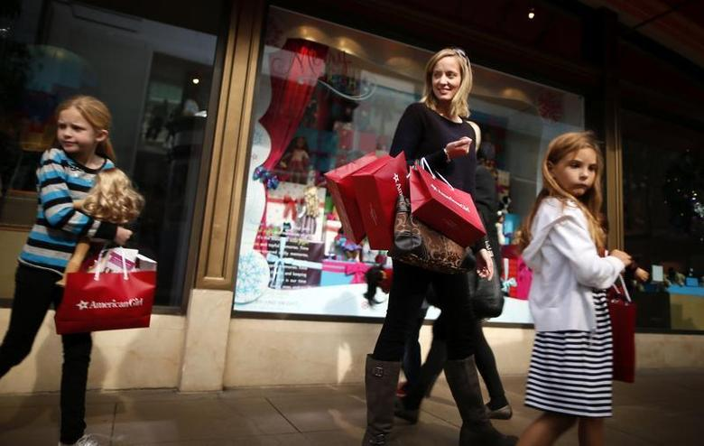 Joanne Bryant, 35, (2nd R) shops with Cariann Bryant, 8, (L) and Katie Sack, 8, at The Grove mall in Los Angeles November 26, 2013. REUTERS/Lucy Nicholson