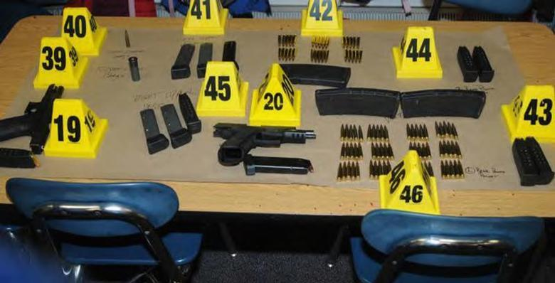 Weapons and ammunitions belonging to Sandy Hook Elementary school gunman Adam Lanza in Newtown, Connecticut are seen after its recovery at the school in this police evidence photo released by the state's attorney's office November 25, 2013. REUTERS/Connecticut Department of Justice/Handout via Reuters