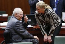 Germany's Finance Minister Wolfgang Schaeuble talks to his Finnish counterpart Jutta Urpilainen (R) during a European Union finance ministers meeting in Brussels December 10, 2013. REUTERS/Francois Lenoir
