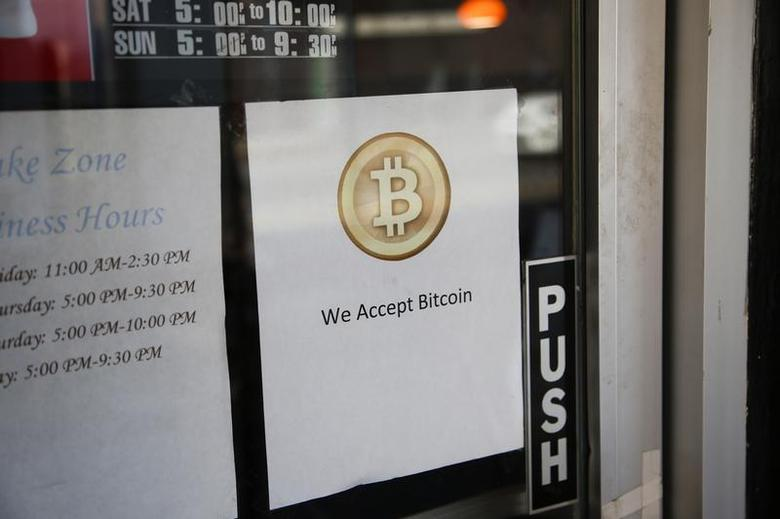 A Bitcoin logo is seen at the window of Sake Zone, a restaurant that accepts Bitcoin, a form of digital currency, as payment in San Francisco, California October 9, 2013. REUTERS/Stephen Lam