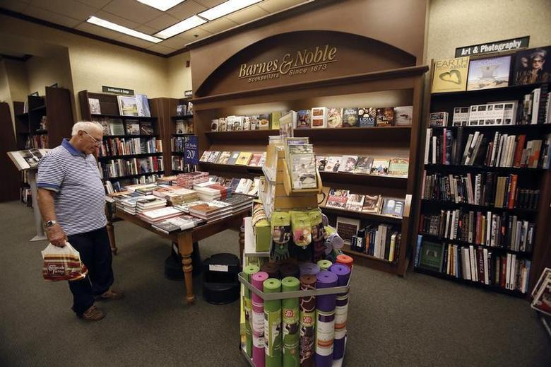 A patron looks at books at a Barnes & Noble bookstore in Pasadena, California November 26, 2013. REUTERS/Mario Anzuoni