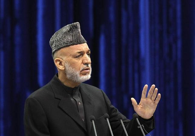 Afghan President Hamid Karzai speaks during the opening of the Loya Jirga, in Kabul November 21, 2013. REUTERS/Omar Sobhani
