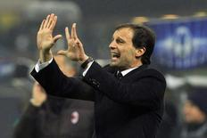 AC Milan's coach Massimiliano Allegri reacts during their Champions League soccer match against Ajax Amsterdam at the San Siro stadium in Milan December 11, 2013. REUTERS/Alessandro Garofalo