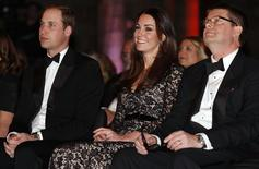 "Britain's Prince William (L-R) and his wife Catherine, the Duchess of Cambridge, sit with Natural History Museum Director Michael Dixon before a screening of ""David Attenborough's Natural History Museum Alive 3D"" at the museum in London December 11, 2013. REUTERS/Suzanne Plunkett"