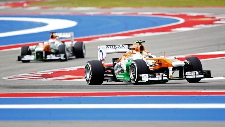Force India Formula One driver Adrian Sutil of Germany (R) and Force India Formula One driver Paul di Resta of Britain drive during the third practice session of the U.S. F1 Grand Prix at the Circuit of the Americas in Austin, Texas November 16, 2013. REUTERS/Mike Stone