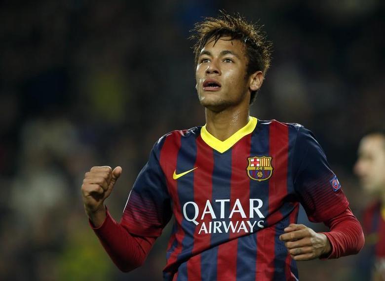 Barcelona's Neymar celebrates after scoring a goal against Celtic during their Champions League soccer match at Camp Nou stadium in Barcelona December 11, 2013. REUTERS/Albert Gea