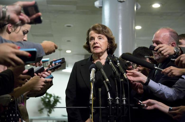U.S. Senator Dianne Feinstein (D-CA) (C), chairman of the Senate Select Committee on Intelligence, speaks to reporters after departing a full-Senate briefing by Director of the National Security Agency General Keith Alexander (not pictured), at the U.S. Capitol in Washington, June 13, 2013. REUTERS/Jonathan Ernst
