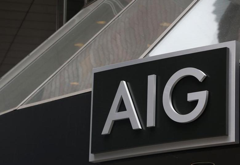 A new sign is displayed over the entrance to the AIG headquarters offices in New York's financial district, January 9, 2013. REUTERS/Brendan McDermid