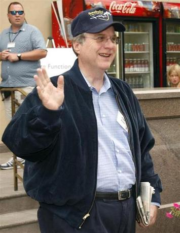 Microsoft co-founder Paul Allen waves during lunch at the Allen and Co. conference at the Sun Valley Resort in Idaho July 12, 2007. REUTERS/Rick Wilking