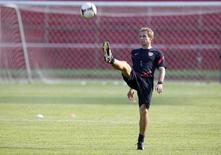 U.S. head coach Juergen Klinsmann kicks the ball during a practice session in San Pedro Sula February 5, 2013. REUTERS/Stringer