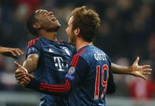 Bayern Munich's Mario Goetze (R) celebrates with David Alaba after scoring a goal against Manchester City during their Champions League Group D soccer match in Munich December 10, 2013. REUTERS/Michael Dalder