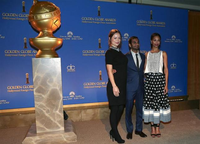 (L-R) Actors Olivia Wilde, Aziz Ansari and Zoe Saldana pose at the announcement of nominations for the 71st annual Golden Globe Awards in Beverly Hills, California December 12, 2013. REUTERS/Jonathan Alcorn