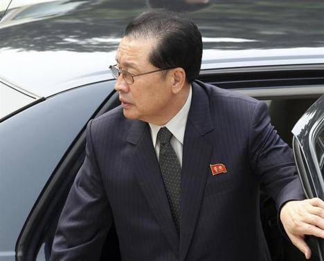 Jang song-thaek, Chief of the Central Administrative Department of the Workers' Party of Korea, exits a car as he arrives at the Ziguangge building of Zhongnanhai, the central government compound, in Beijing, August 17, 2012. REUTERS-China Daily