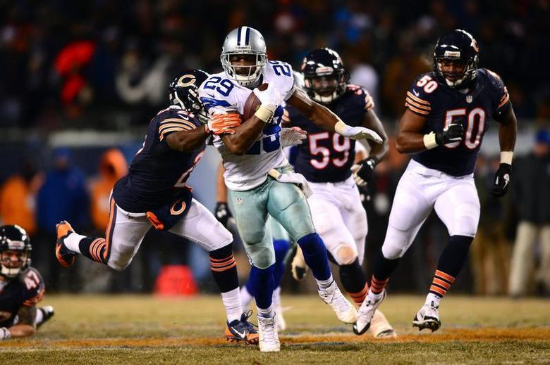 Dec 9, 2013; Chicago, IL, USA; Dallas Cowboys running back DeMarco Murray (29) runs the ball during the fourth quarter against the Chicago Bears at Soldier Field. Andrew Weber-USA TODAY