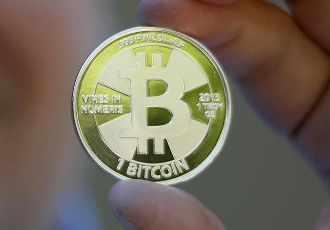 Some of Bitcoin enthusiast Mike Caldwell's coins in this photo illustration at his office in Sandy, Utah, September 17, 2013. REUTERS/Jim Urquhart
