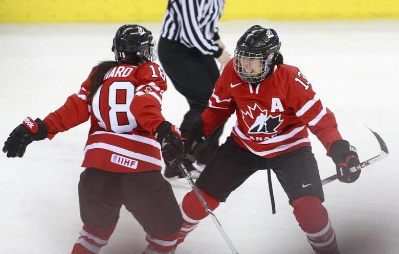 Canada's Caroline Ouellette (R) celebrates her goal with team mate Catherine Ward during the second period of their gold medal game against the U.S. at the IIHF Ice Hockey Women's World Championship in Ottawa April 9, 2013. REUTERS/Blair Gable