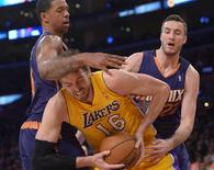 Los Angeles Lakers forward Pau Gasol (16) is defended by Phoenix Suns forward Channing Frye (8) and center Miles Plumlee (22) at Staples Center. Kirby Lee-USA TODAY