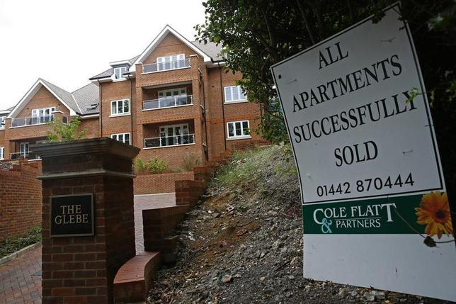 A sign is seen outside some newly built apartments in Berkhamsted, southern England August 13, 2013. REUTERS/Eddie Keogh