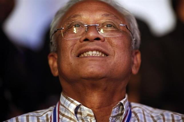 Anti-government protest leader Suthep Thaugsuban smiles before addressing his supporters from the stage near the Government house in Bangkok December 10, 2013. REUTERS/Damir Sagolj