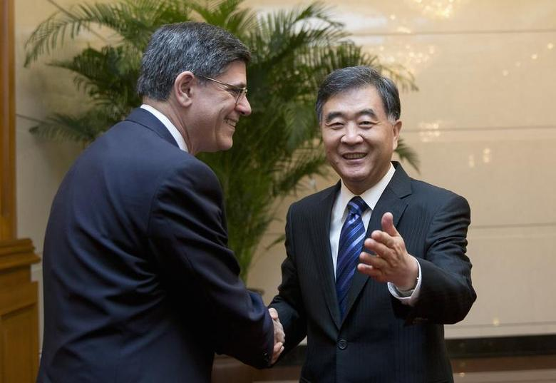U.S. Treasury Secretary Jack Lew (L) shakes hands with Chinese Vice Premier Wang Yang as they arrive for a meeting at the Diaoyutai State Guesthouse in Beijing November 15, 2013. REUTERS/Andy Wong/Pool
