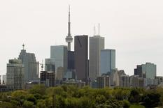 The Toronto Skyline with a condominium building under construction (L) is shown in downtown Toronto, May 14, 2009. REUTERS/ Mike Cassese