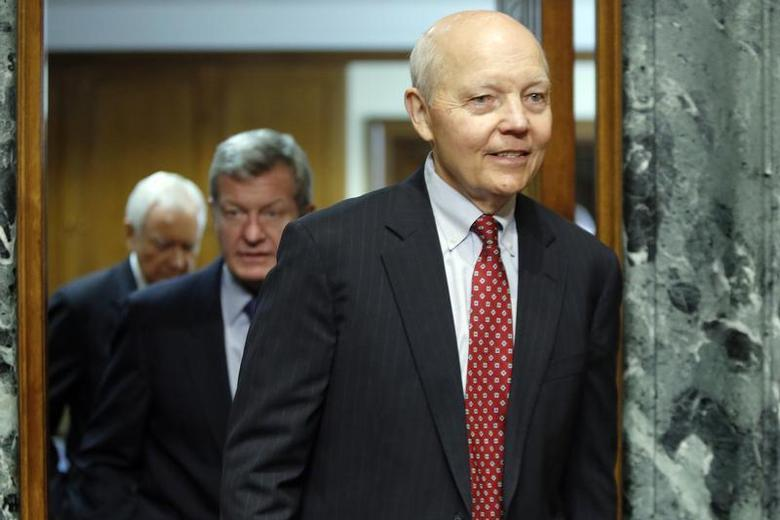 John Koskinen (R) returns from a break with Committee Chairman Senator Max Baucus (D-MT) (2nd L) and ranking member Orrin Hatch (R-UT) (L) to resume testimony before a Senate Finance Committee confirmation hearing on his nomination to be commissioner of the Internal Revenue Service (IRS) on the Capitol Hill in Washington, December 10, 2013. REUTERS/Jonathan Ernst